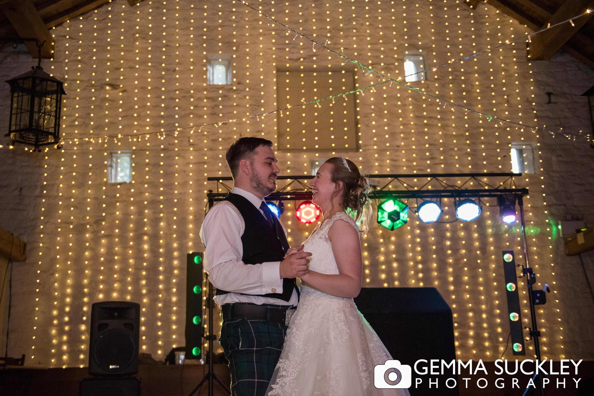 bride and groom first dance at east riddlesden hall