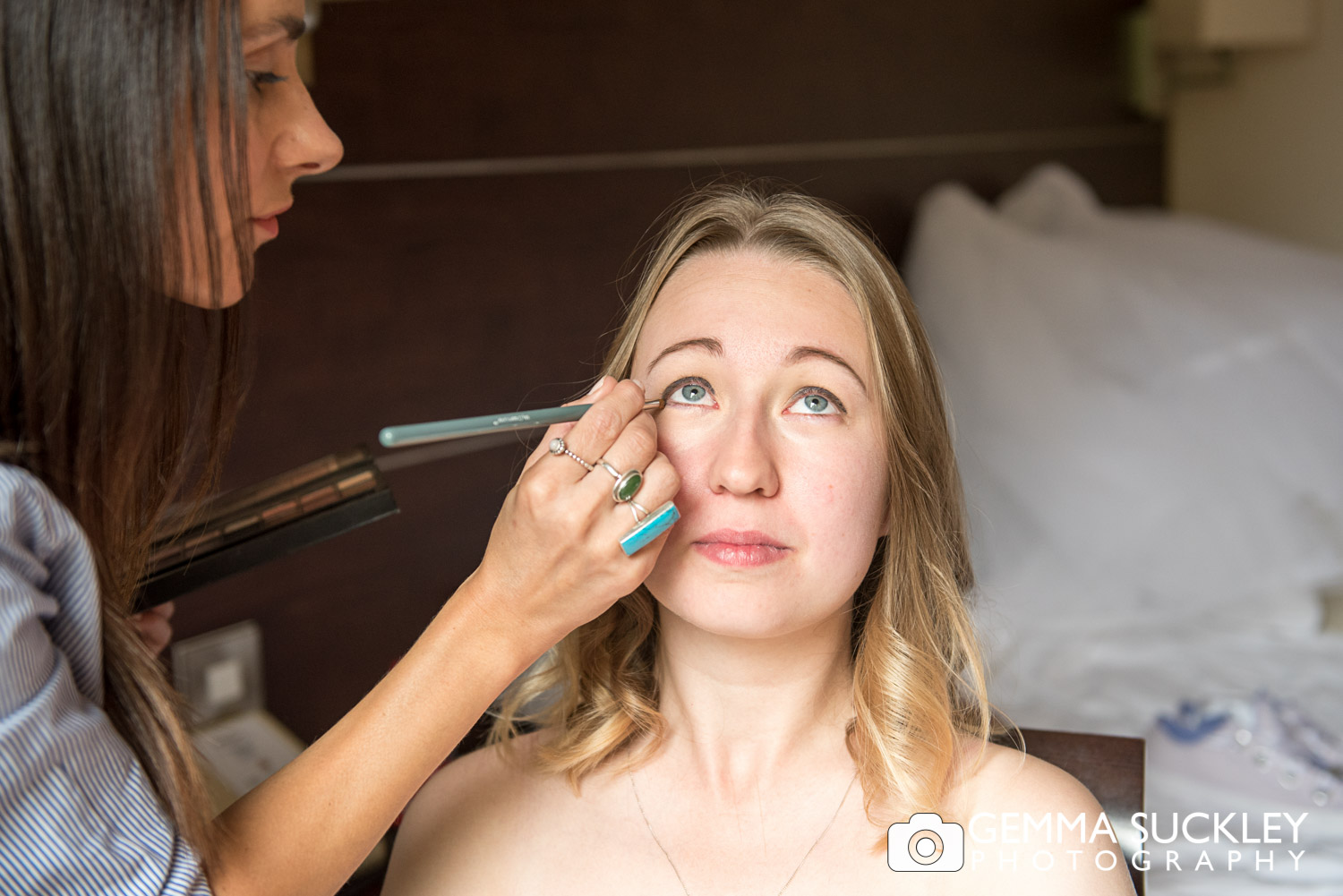 bride having her make-up done at mercure hotel