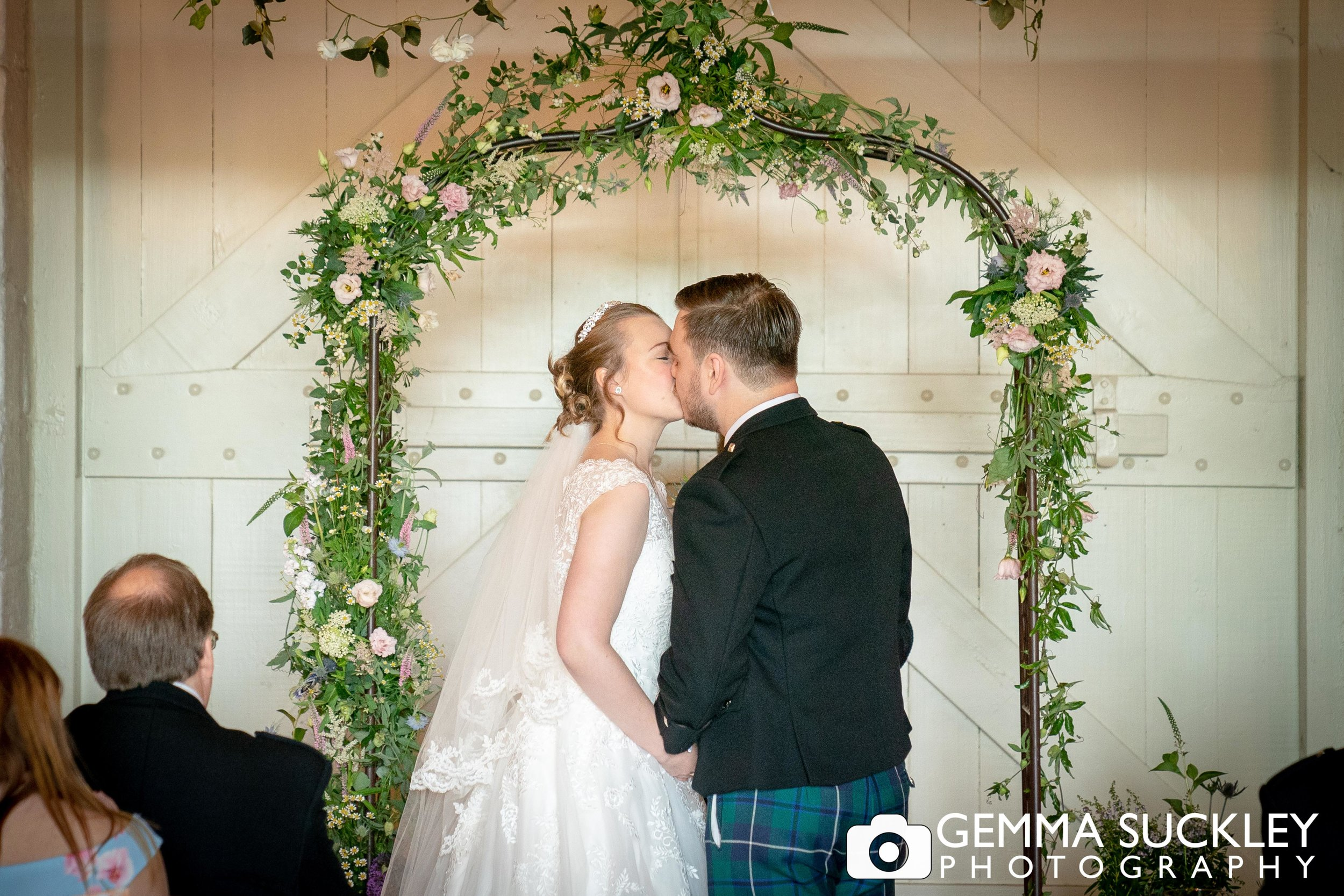 bride and groom just married at east riddlesden hall