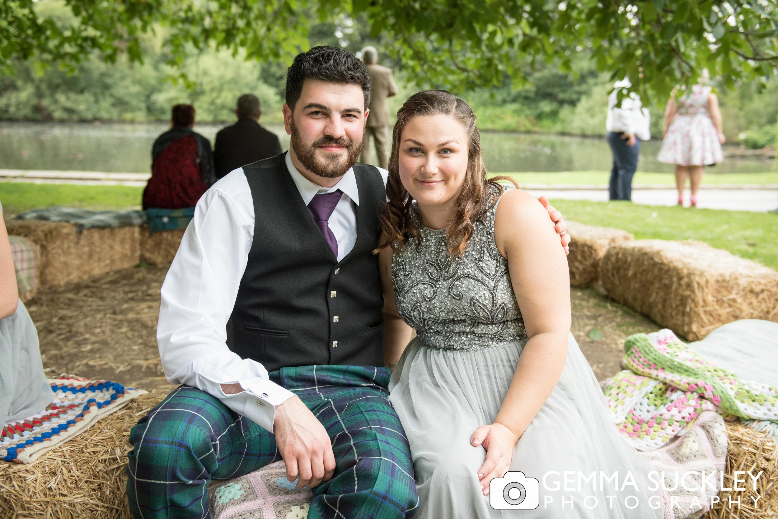 couple sat on the hay bails at east riddlsden hall