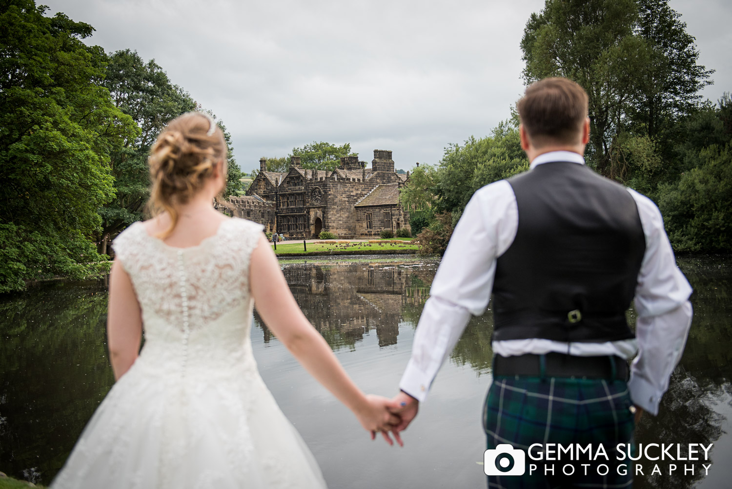 bride and groom looking at east riddlesden hall