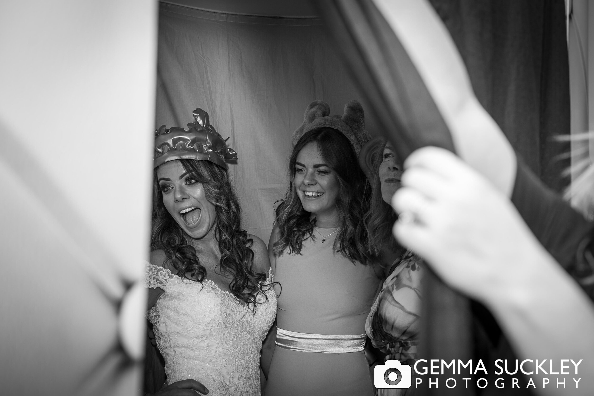 bride laughing in the photo booth
