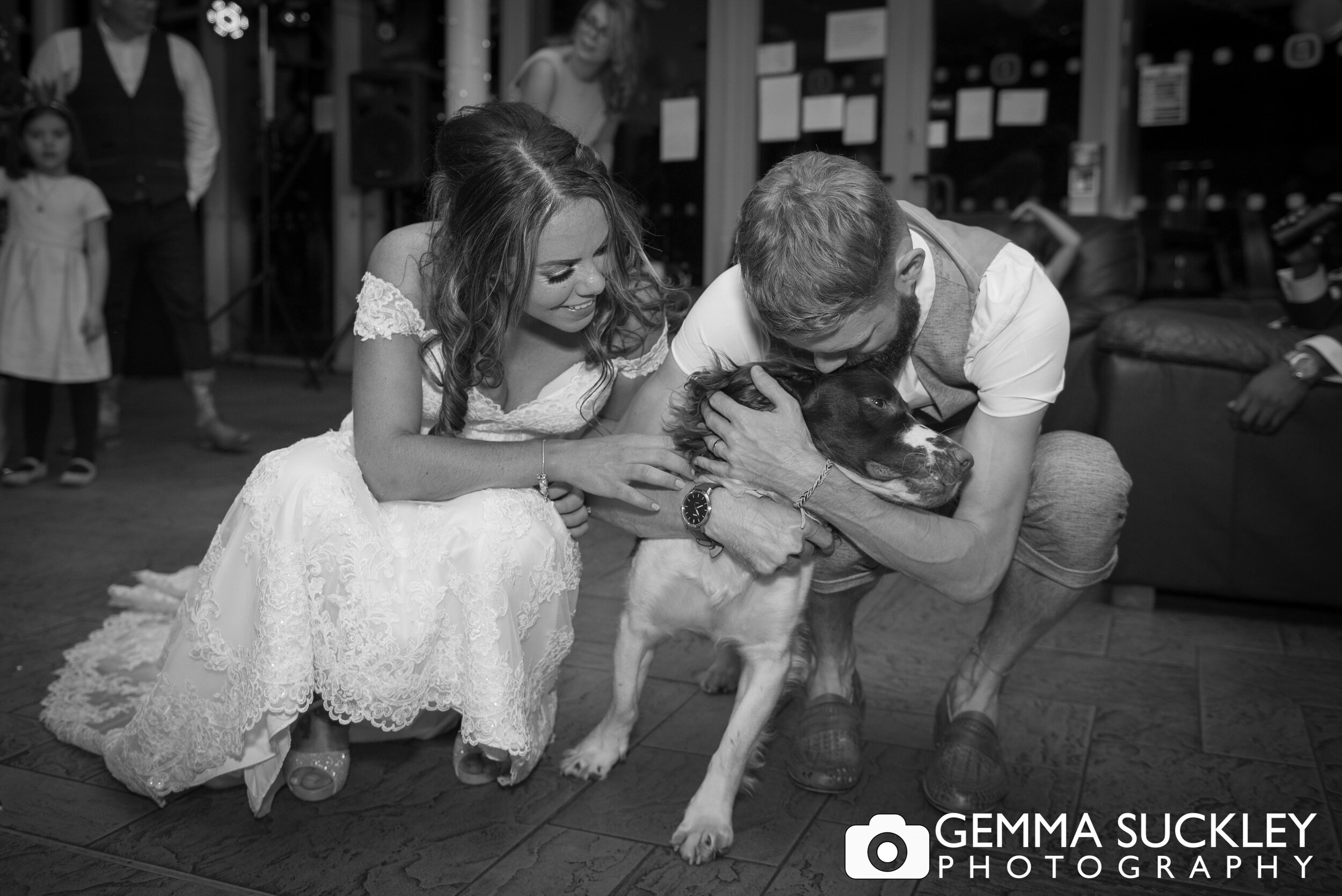 bride and groom with their dog at coffee culture in halifax