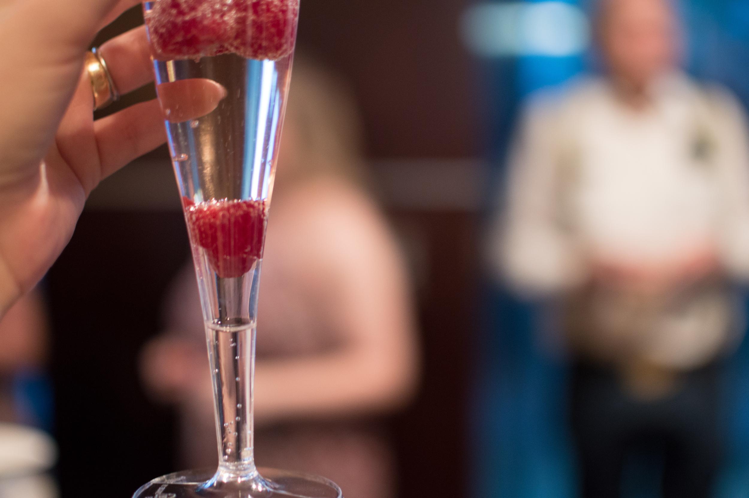wedding reception raspberry champagne toast