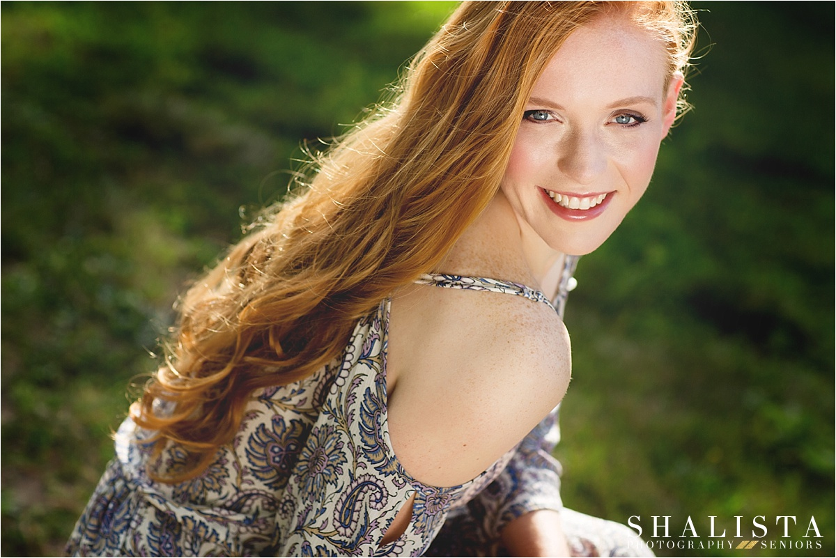 Smiling girl with red hair.