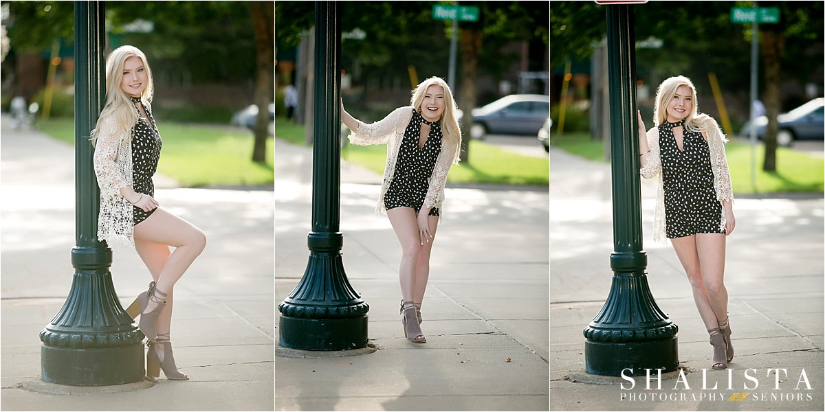Senior girl downtown by lamp posts