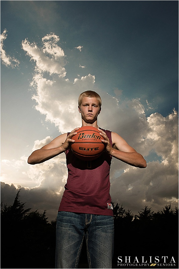 Shalista Photography - Sioux Falls Senior Photos Boy with clouds behind him
