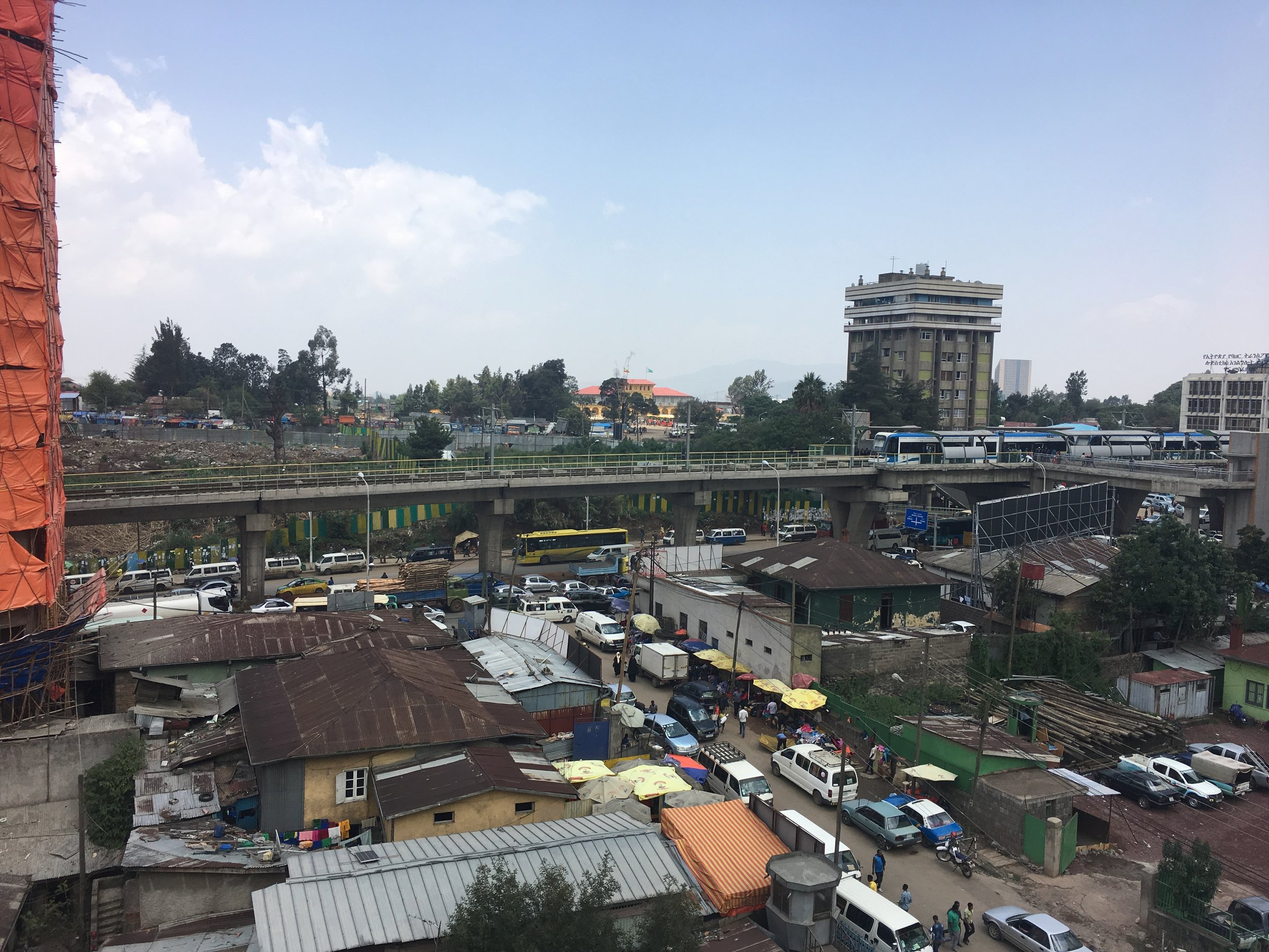 A view of downtown streets and the new metro line from the rooftop of the Ethiopian Development Research Institute.
