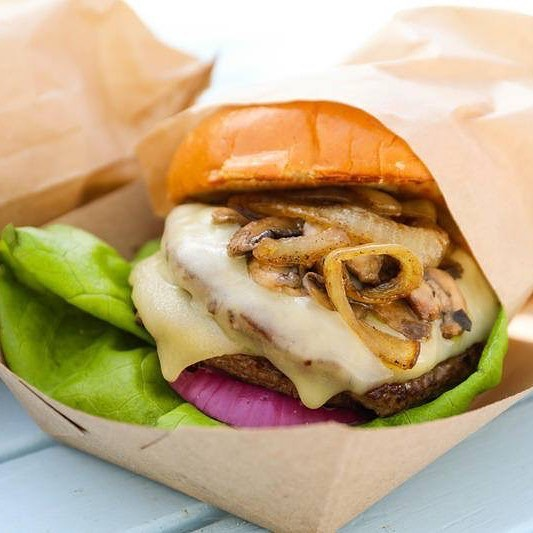 Feast your eyes on our all-new Swiss Mushroom Burger. This treat is a double patty topped with melted Swiss cheese and caramelized wild mushrooms & onions.