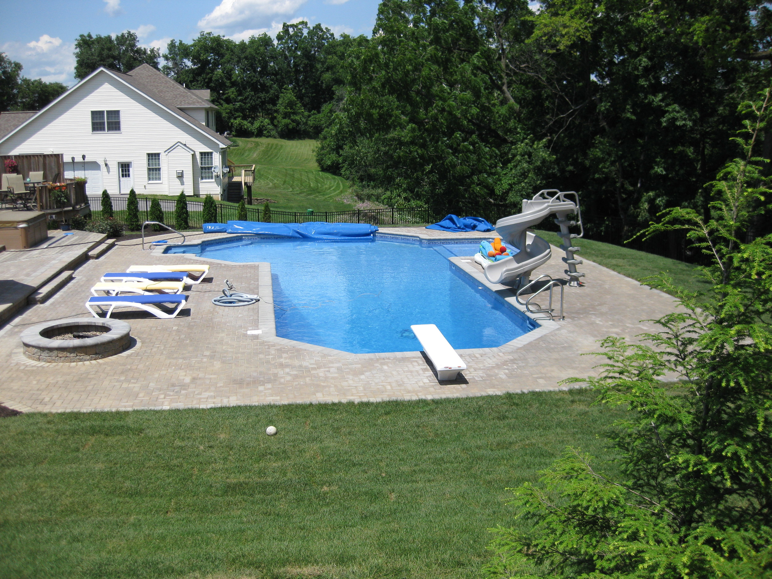 Custom Pool with EP Henry Hardscapes and Fire Pit