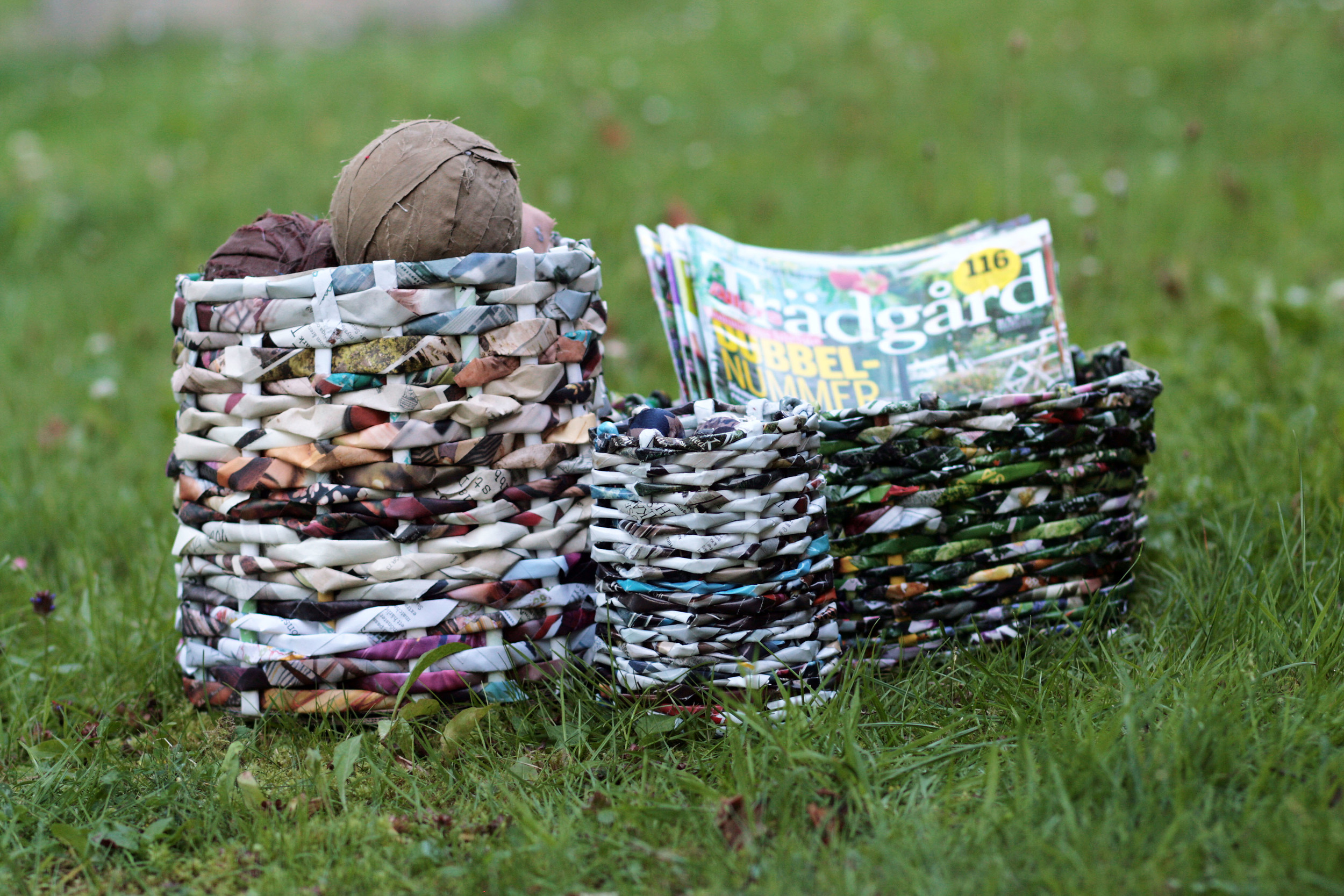 Baskets made of magazines and catalogs.