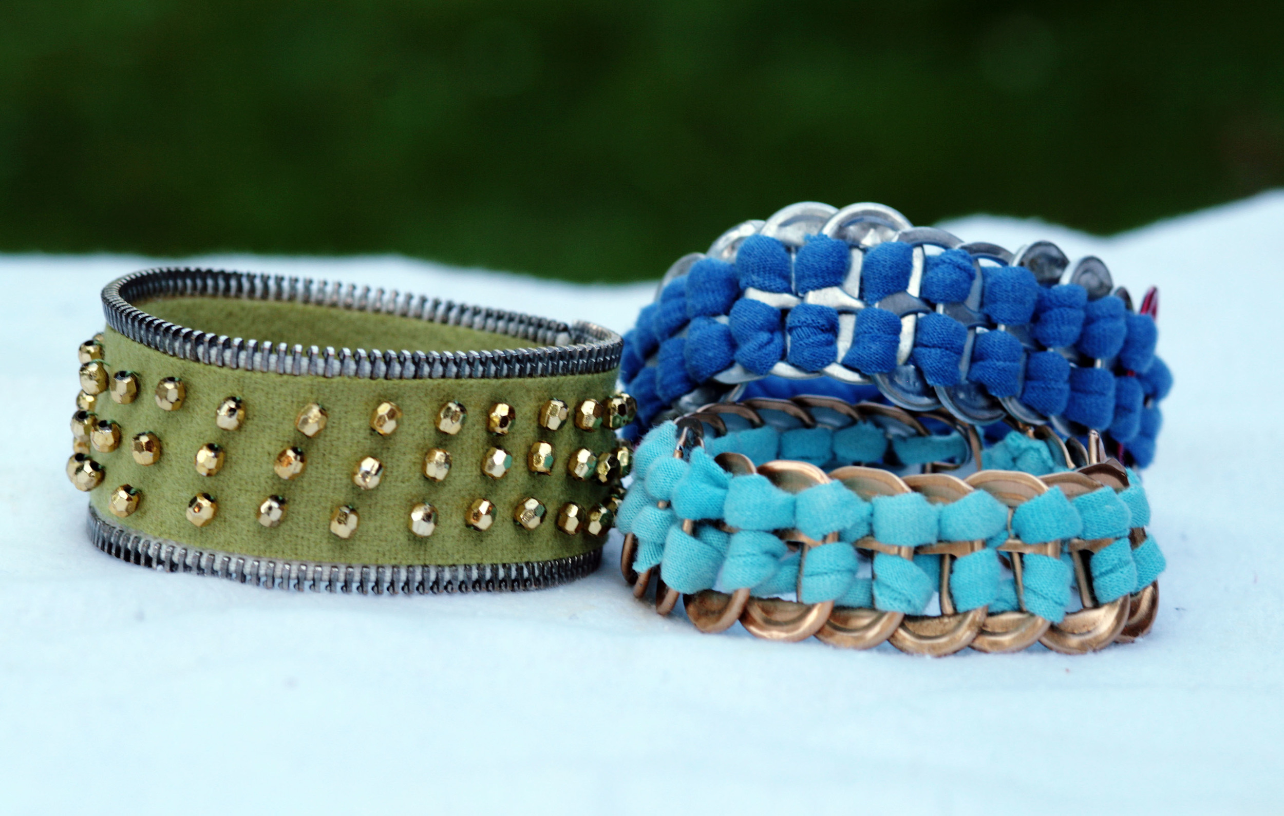 Bracelets made of a zipper and soda tabs.