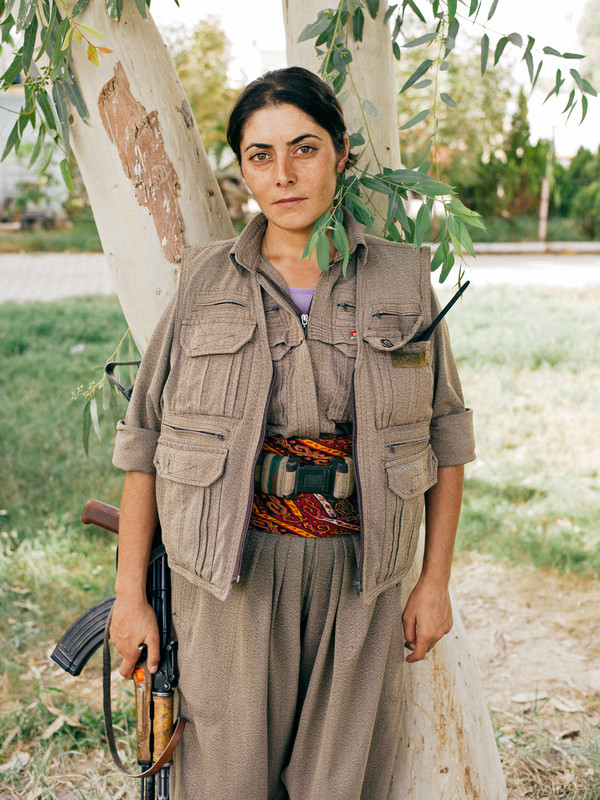 A PKK female fighter is part of a training camp of Makmour in Northern Iraq.