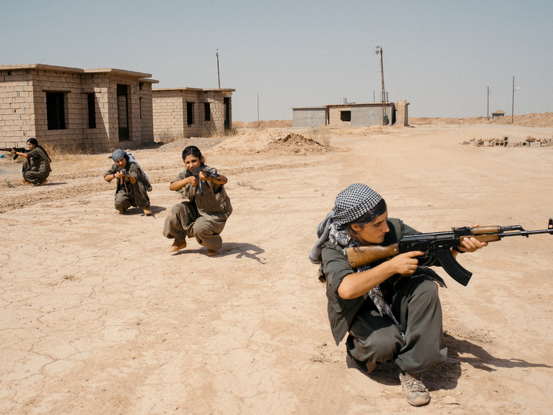 A group of PKK female fighters are training with kalashnikovs inside a PKK camp near the city of Bashir in Northern Iraq.