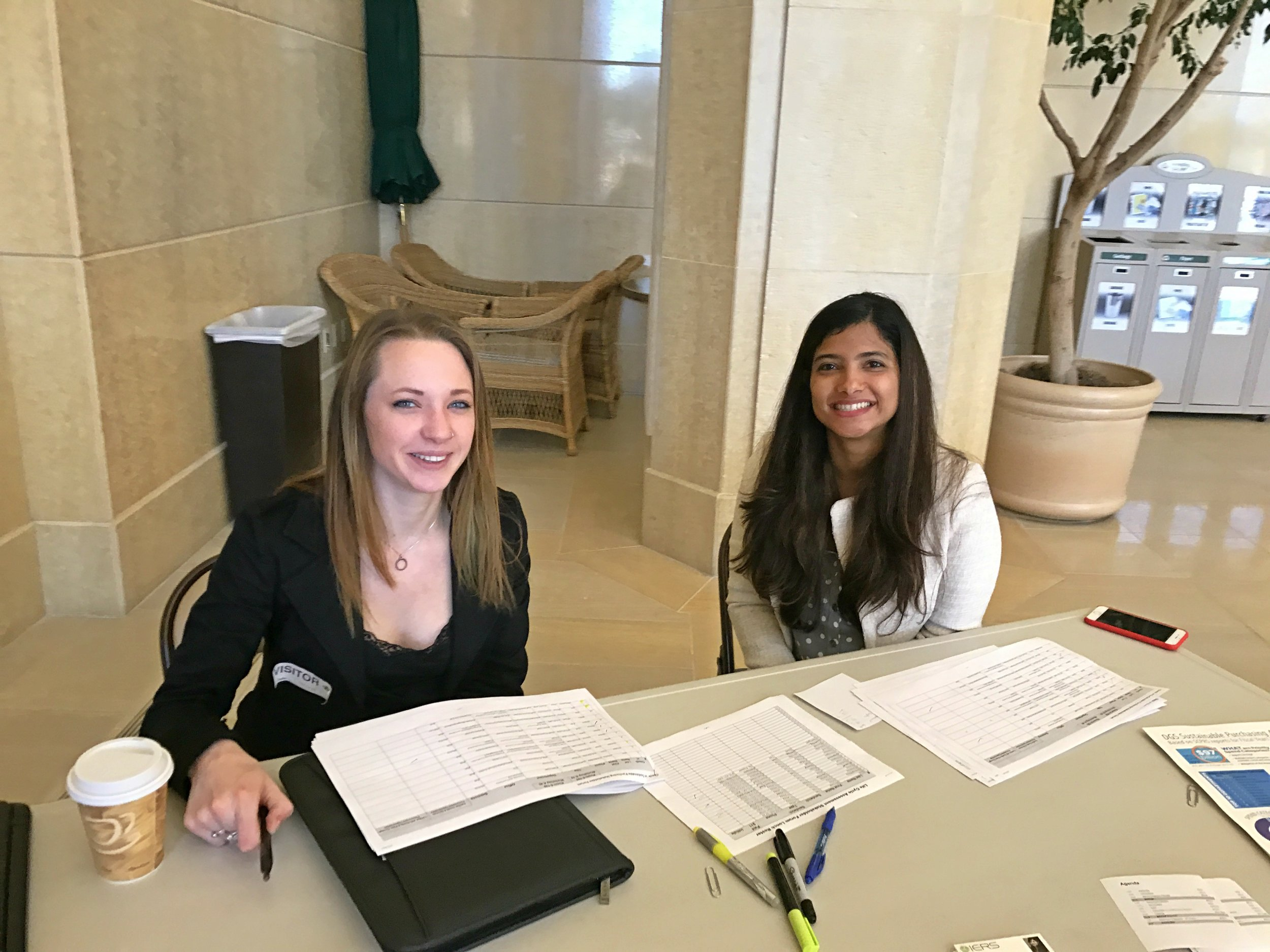 Shivira T. Choudhary and Summer Broeckx-Smith from IERS welcome attendees at check-in