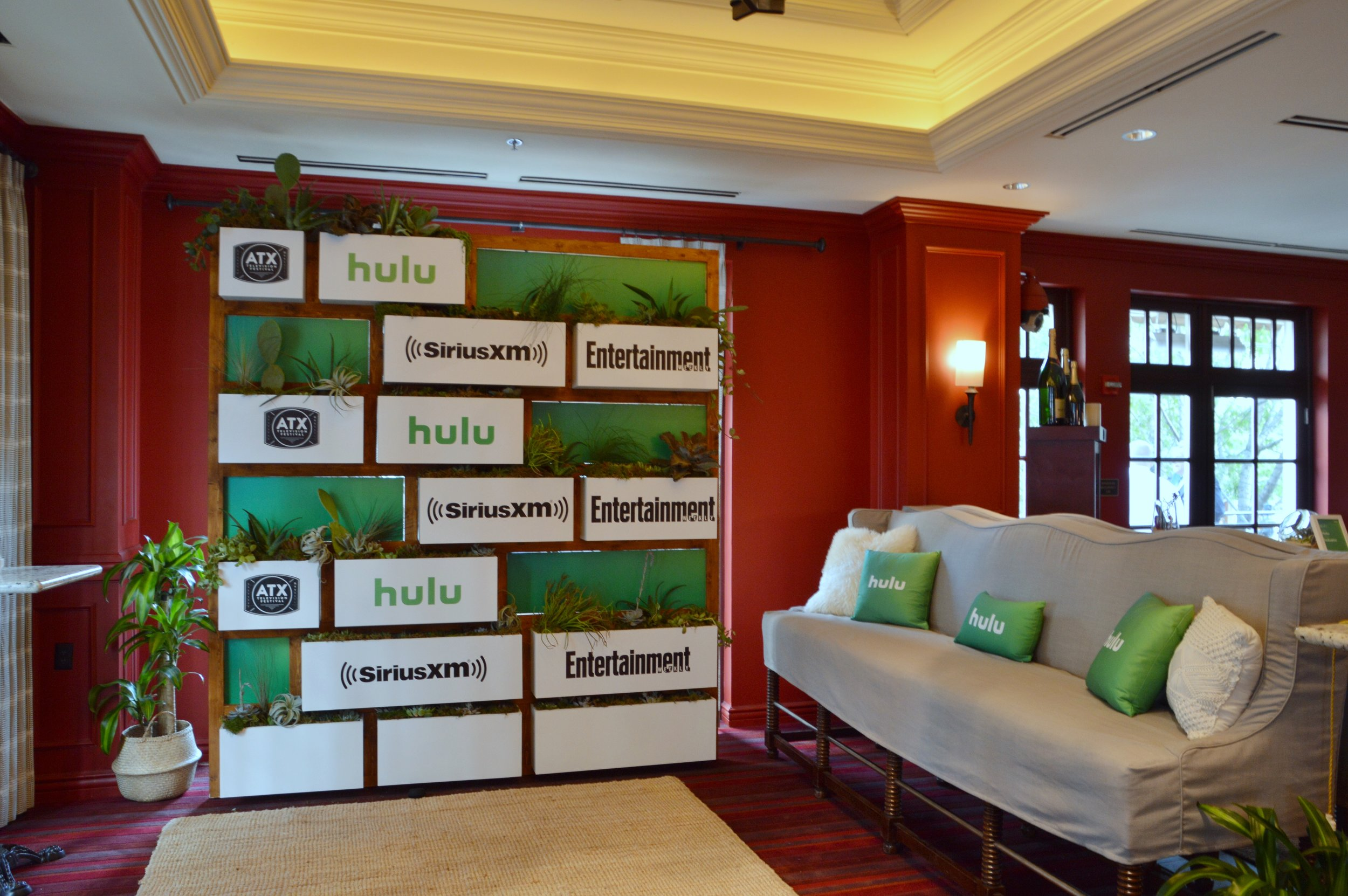 Hulu Lounge at the ATX Television Festival. Custom built step and repeat with real plants.