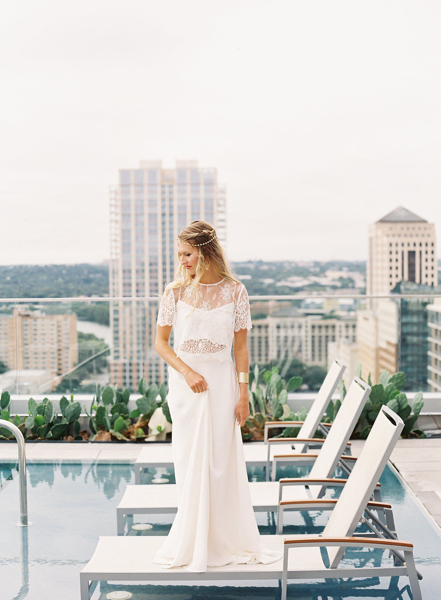 The Fashion: This crop top, lace overlay and high waisted skirt wedding ensemble from Unbridaled is one of my favorite wedding dress trends.