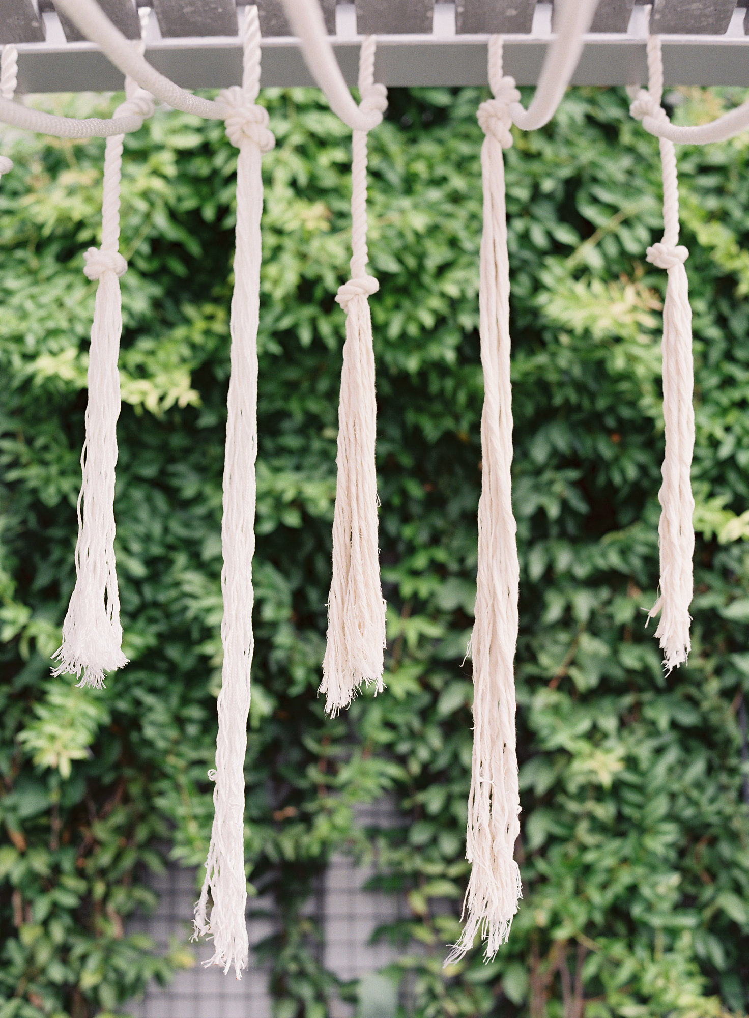 Details: Over the table we created a hanging installation of different lengths of cotton nautical rope bring the tropical theme to the entire styled space.