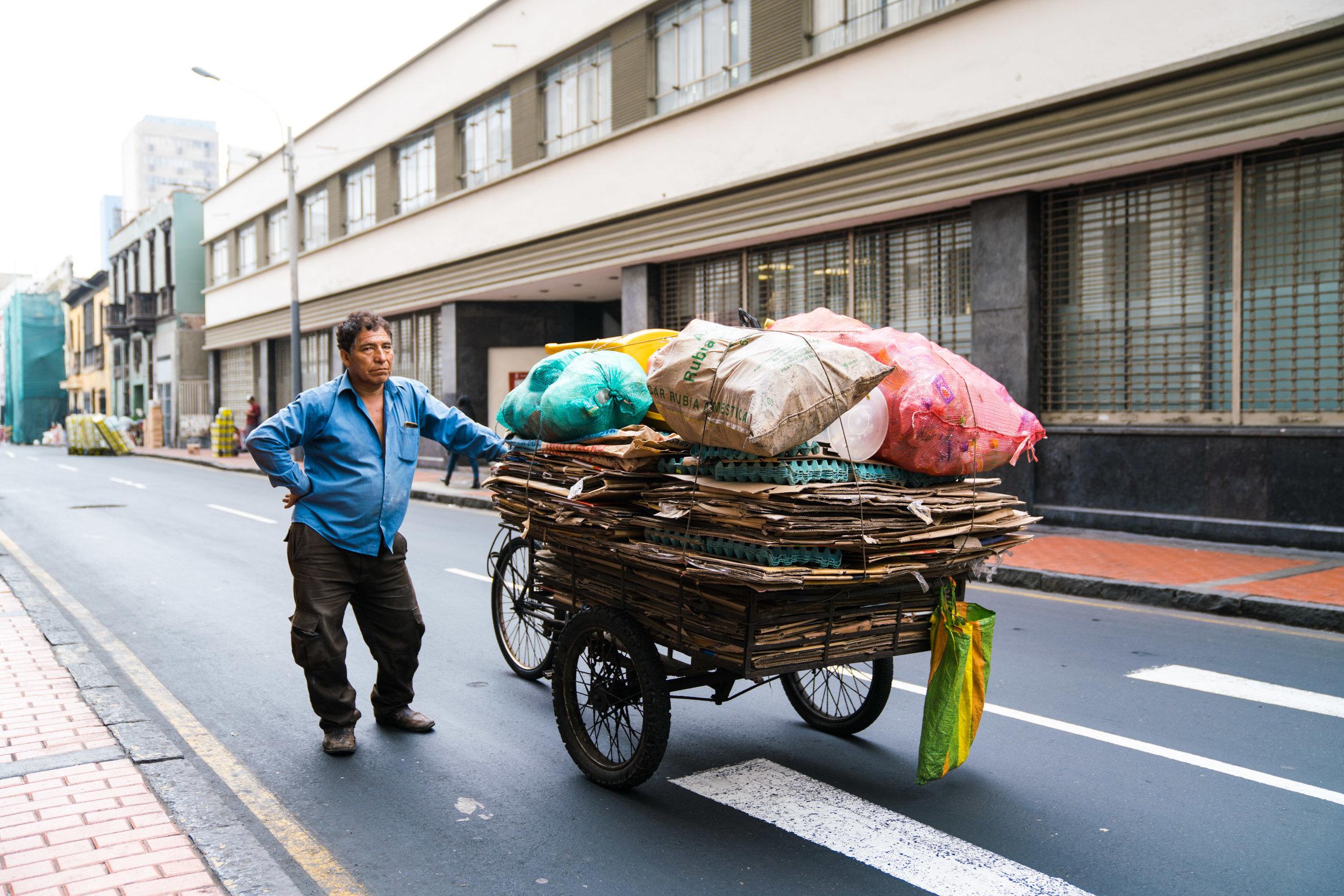 A Peruvian man transports recycling across the city. Lima, Peru. 2018
