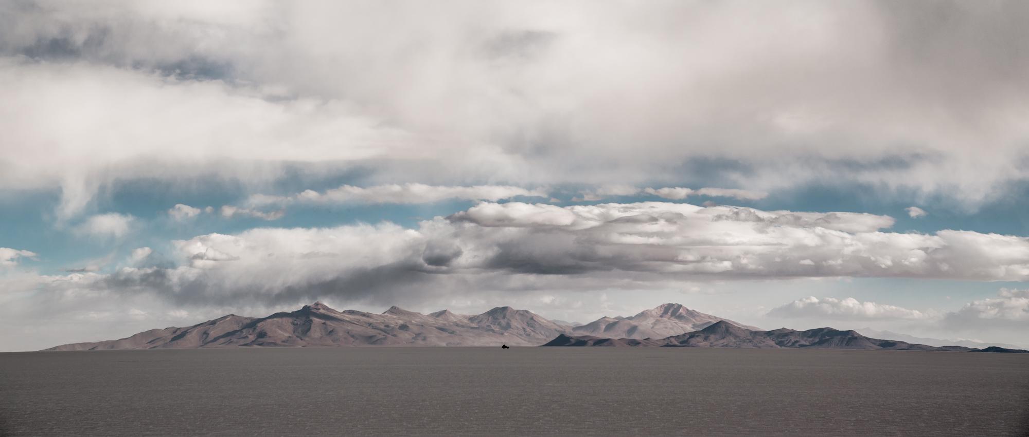 A car passes over the Uyuni salt flats. Bolivia