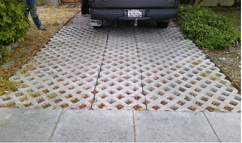 Driveway before- 'pervious pavers' that had settled and were not performing the way the homeowner had hoped.