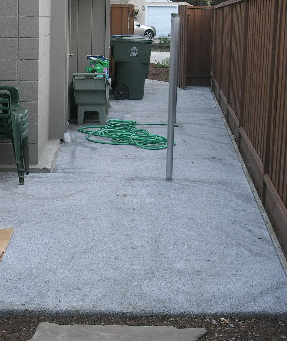 Sideyard after- Now this space can be used for laundry and garbage bin storage.