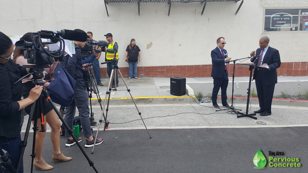 Local press gathered to cover the event