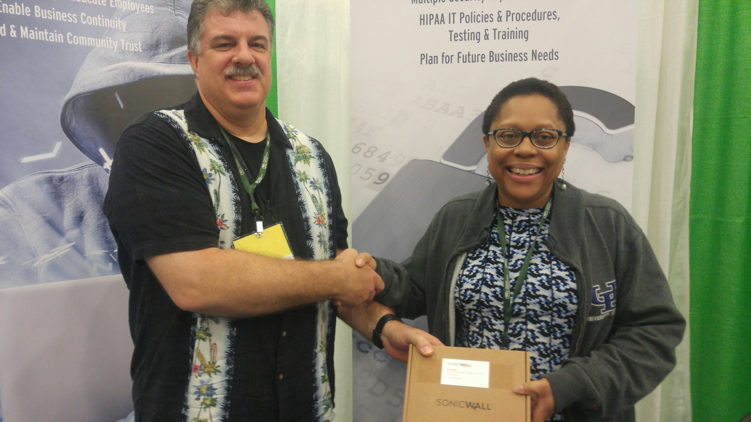 Dan Marcellus, President/CEO, SkyPort IT Congratulates Lekisha Griffin of New Clinton   Pharmacy, Rochester, NY for winning our SonicWall Raffle at the PSSNY Annual Conference!