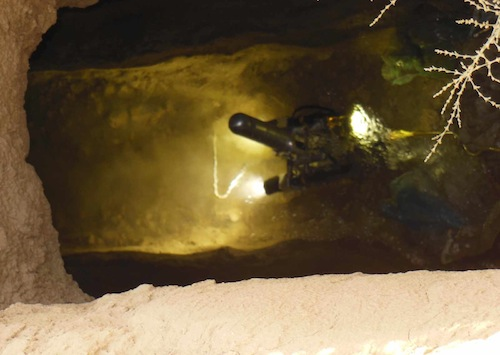 View of the modified pipe inspection robot in a karez from the surface. The capabilities and limitations of this specific robot are still being investigated. Courtesy U.S. Army REF