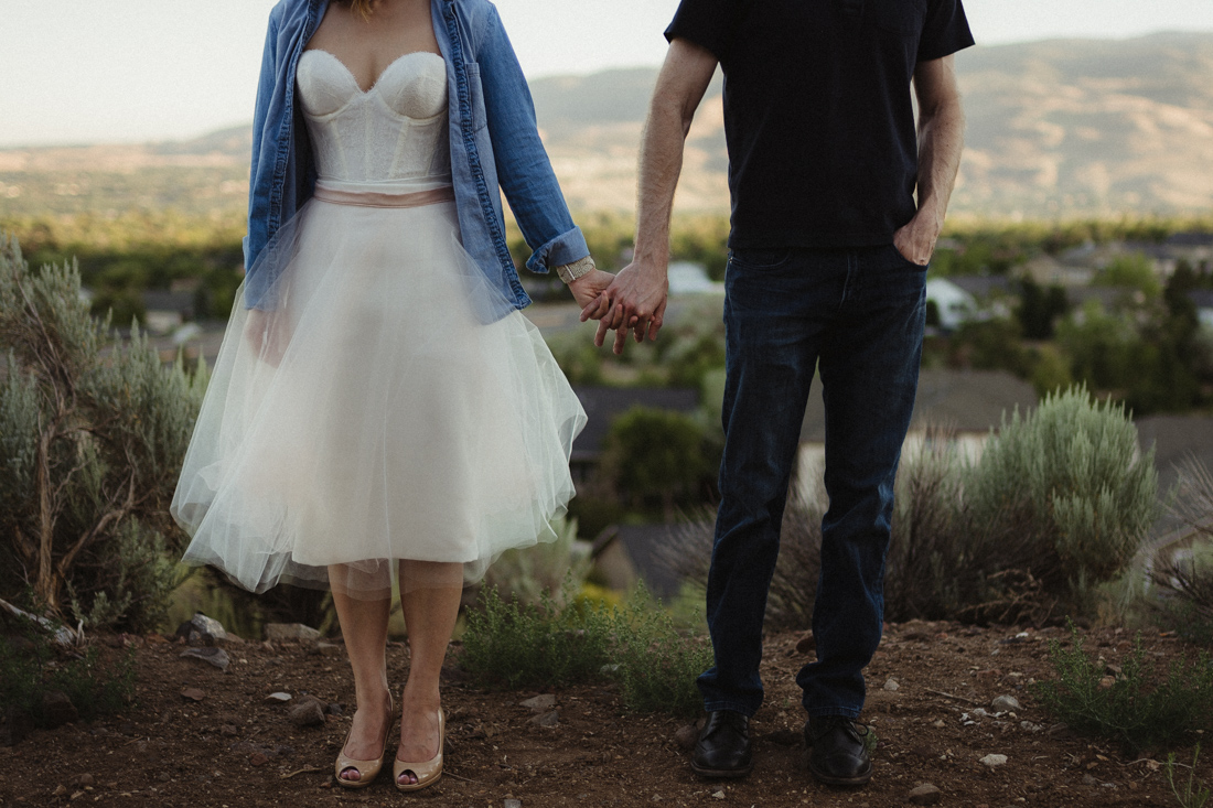 Husband and wife holding hands at Keystone Canyon in Reno, NV