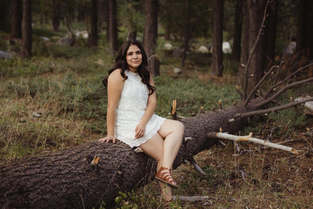 Lake Tahoe senior pictures of a girl sitting on a log