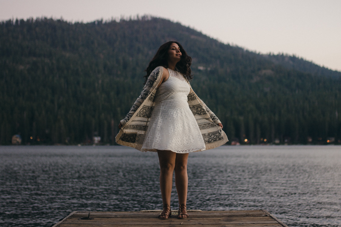Lake Tahoe senior pictures of a girl dancing on the dock at Donner Lake
