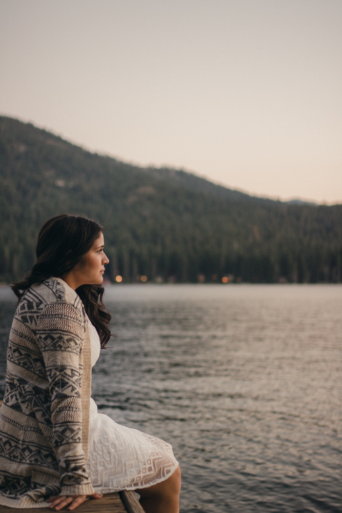 Lake Tahoe senior pictures of a girl sitting on the dock at Donner Lake during Sunset