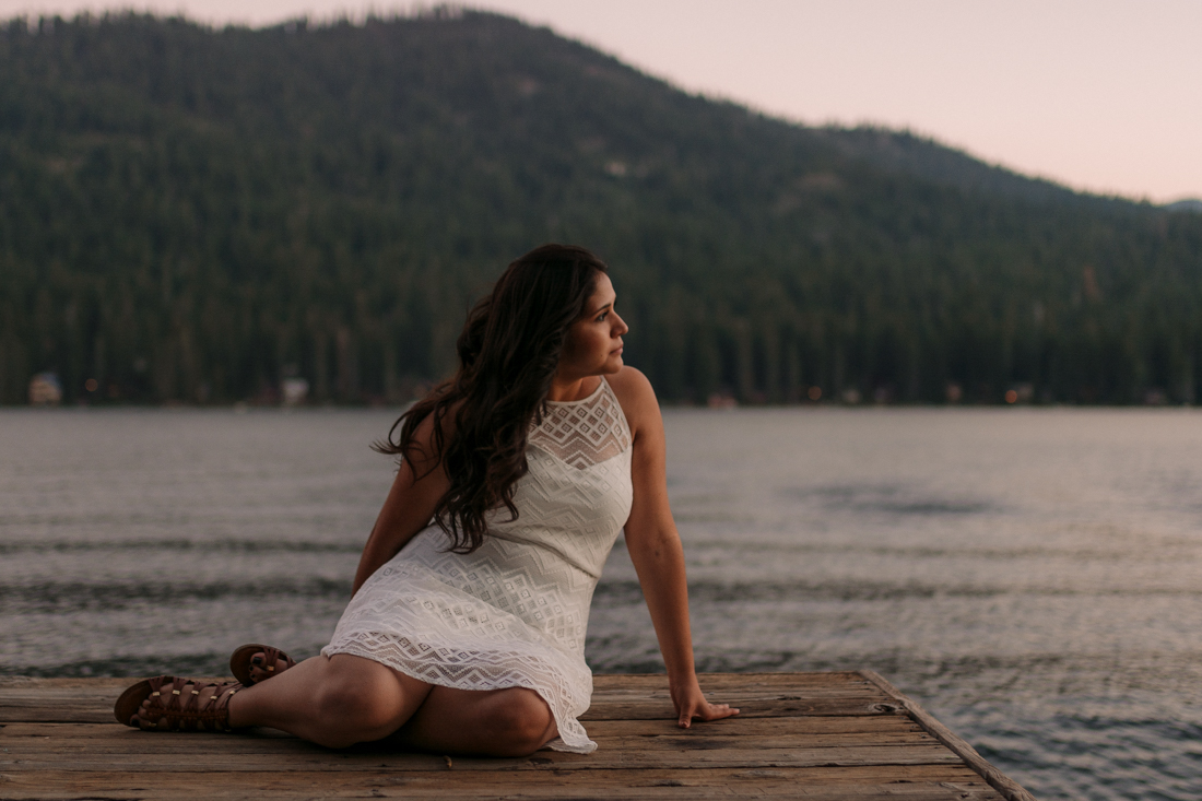 Lake Tahoe senior pictures of a girl sitting at a dock during sunset