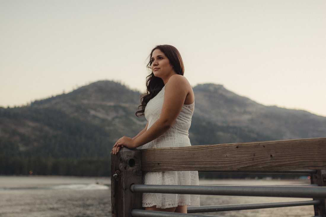 Lake Tahoe senior pictures of a girl looking out on a dock at Donner Lake