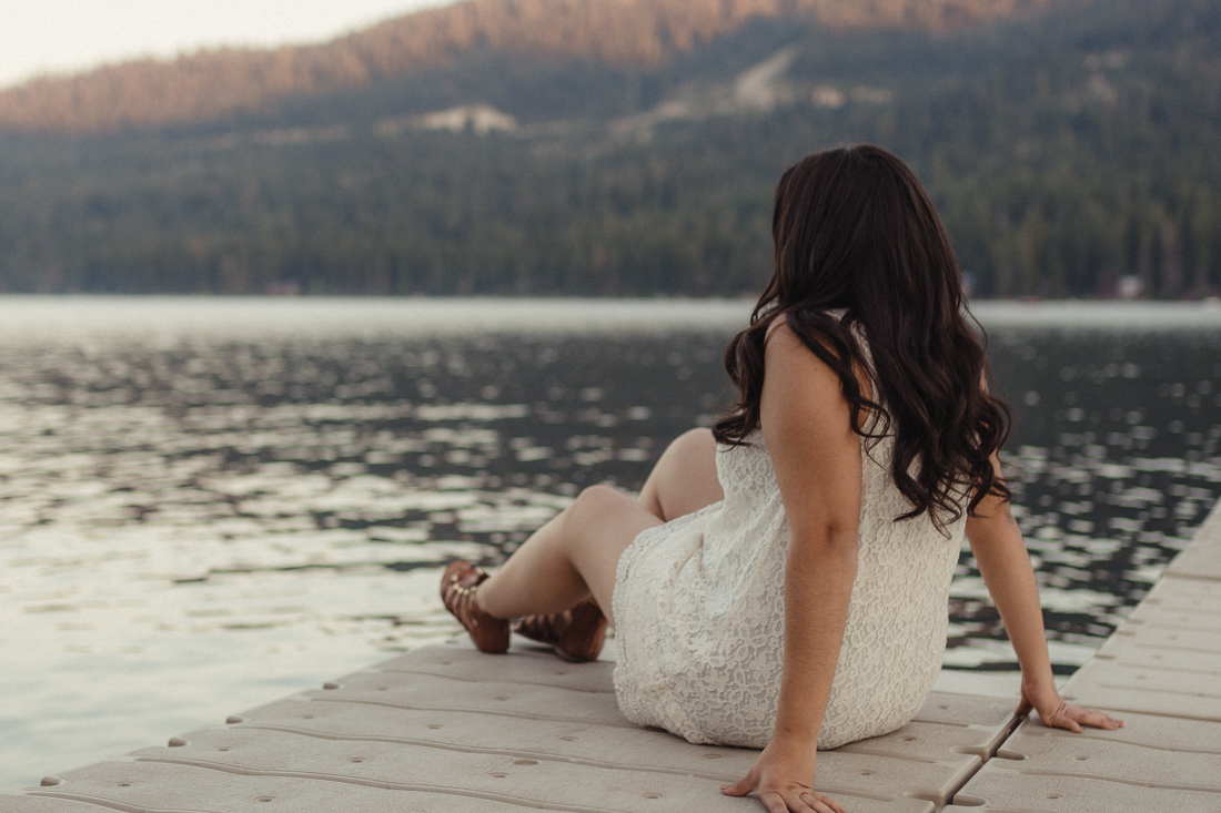 Lake Tahoe senior pictures of a girl sitting on a dock at Donner Lake