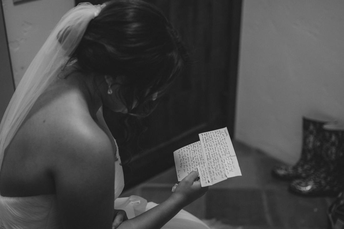 Lake Tahoe California Wedding photographer bride reading note from groom photo