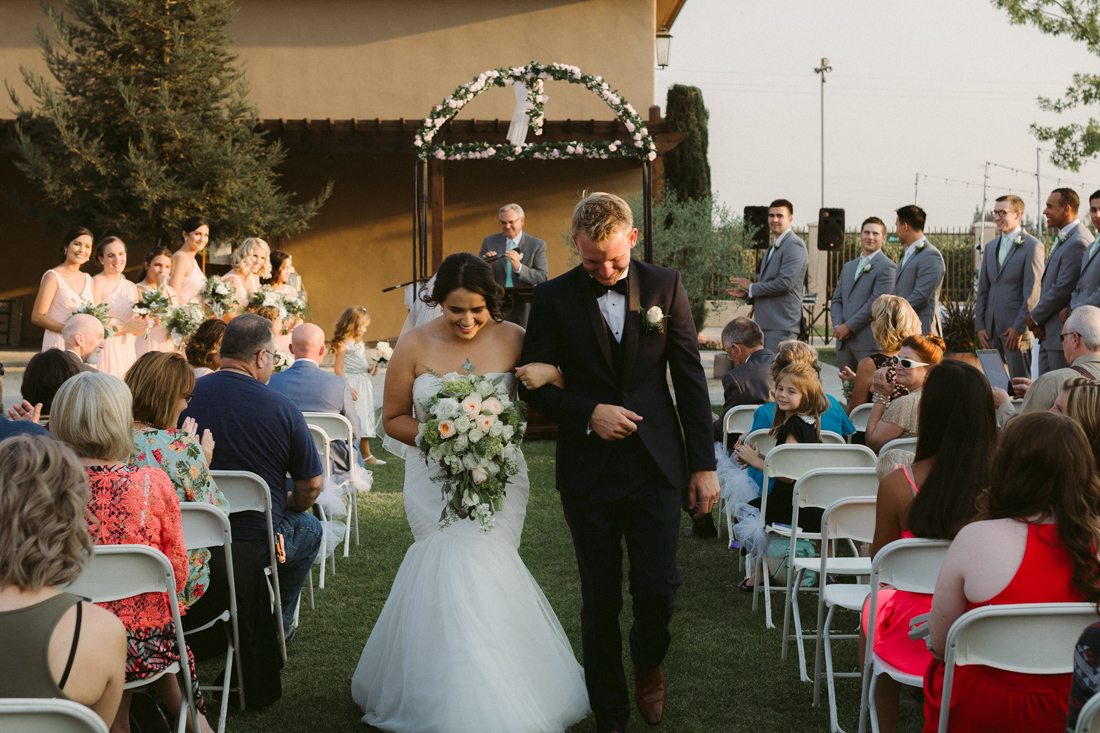 California Wedding private venue bride and grooms walking down the aisle