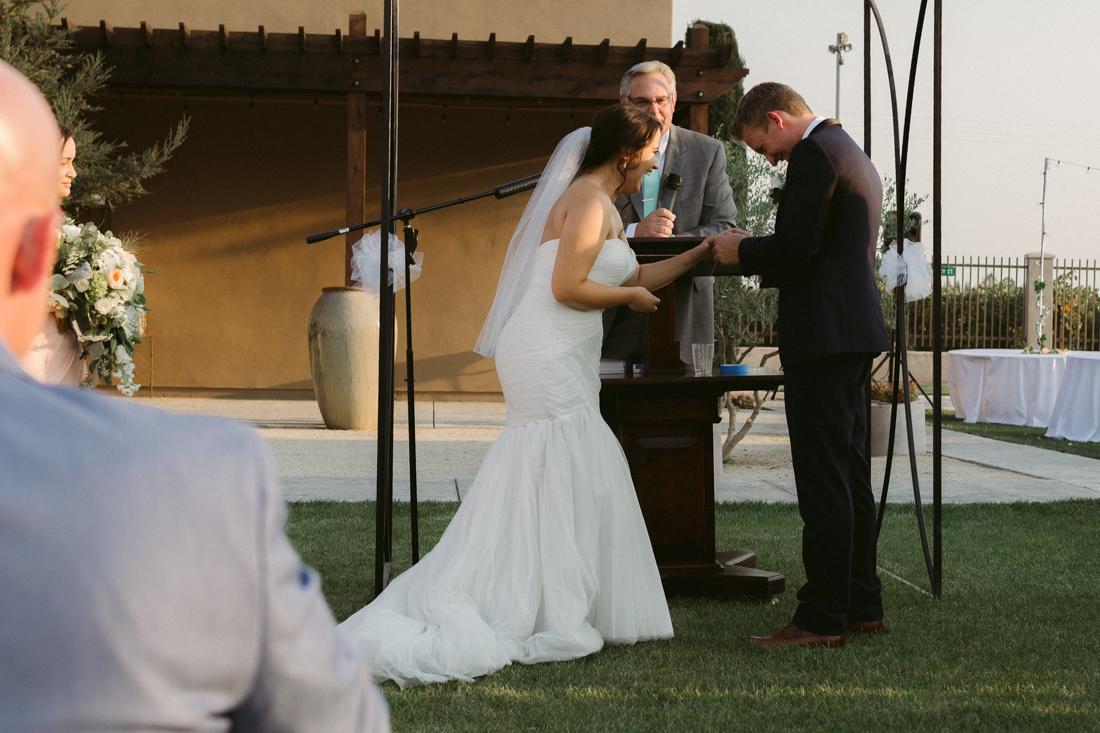 California Wedding private venue bride sliding ring on grooms finger