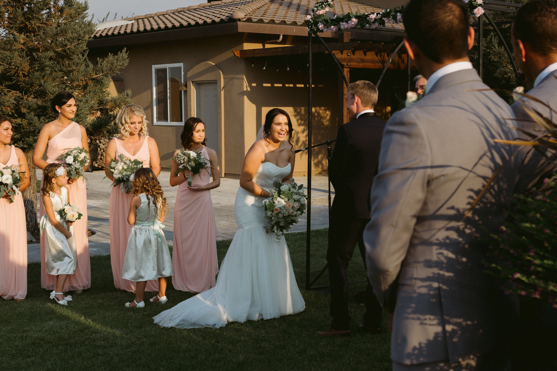 California Wedding private venue bride smiling during the wedding ceremony