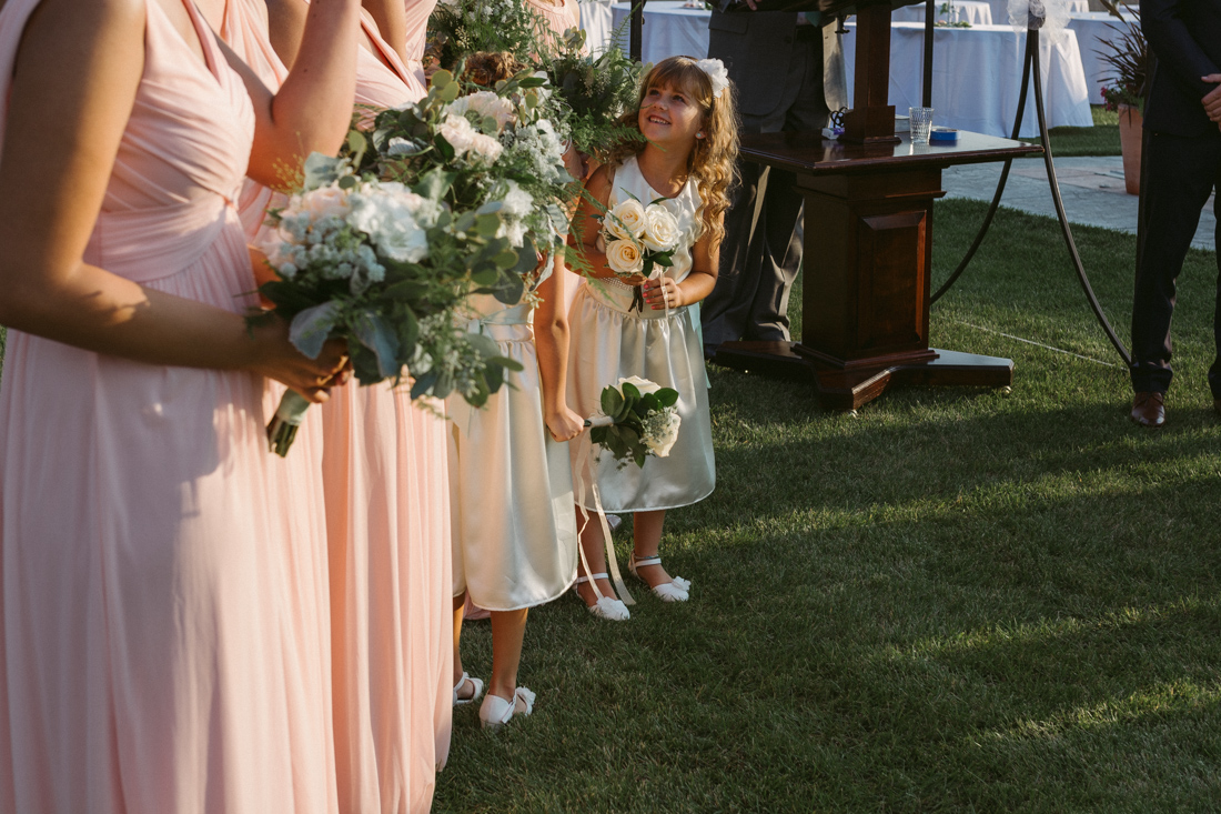 California Wedding private venue flower girl standing next to the bridesmaids