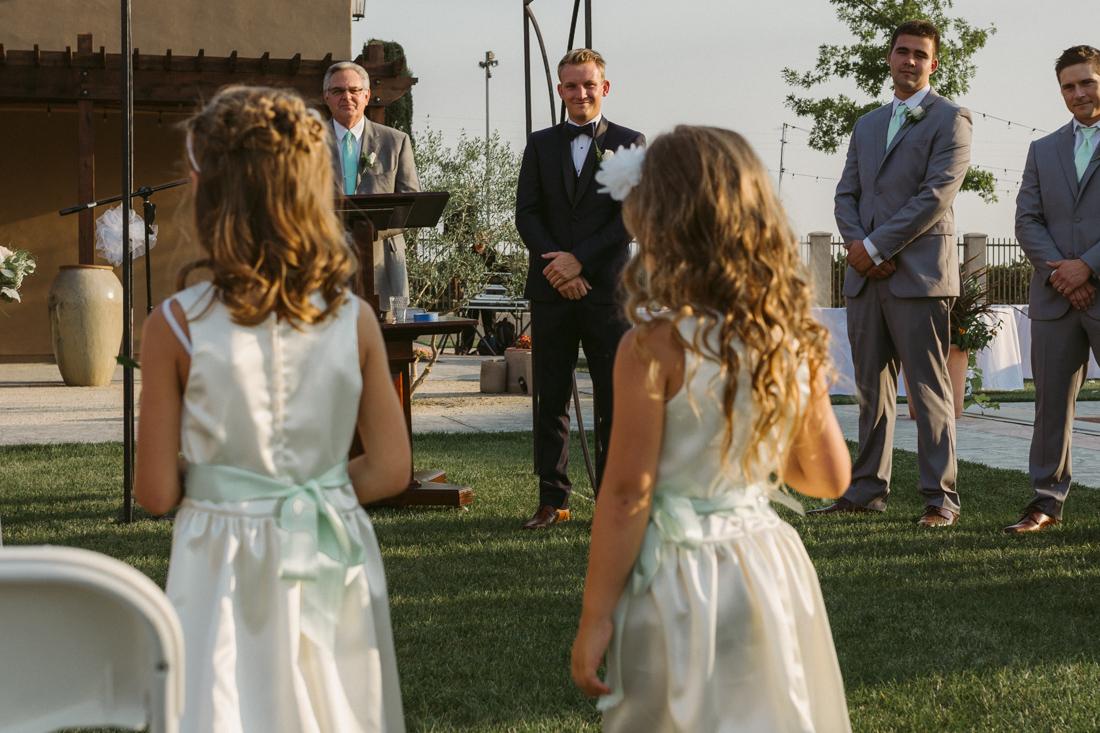 California Wedding private venue flower girls walking down the aisle photo