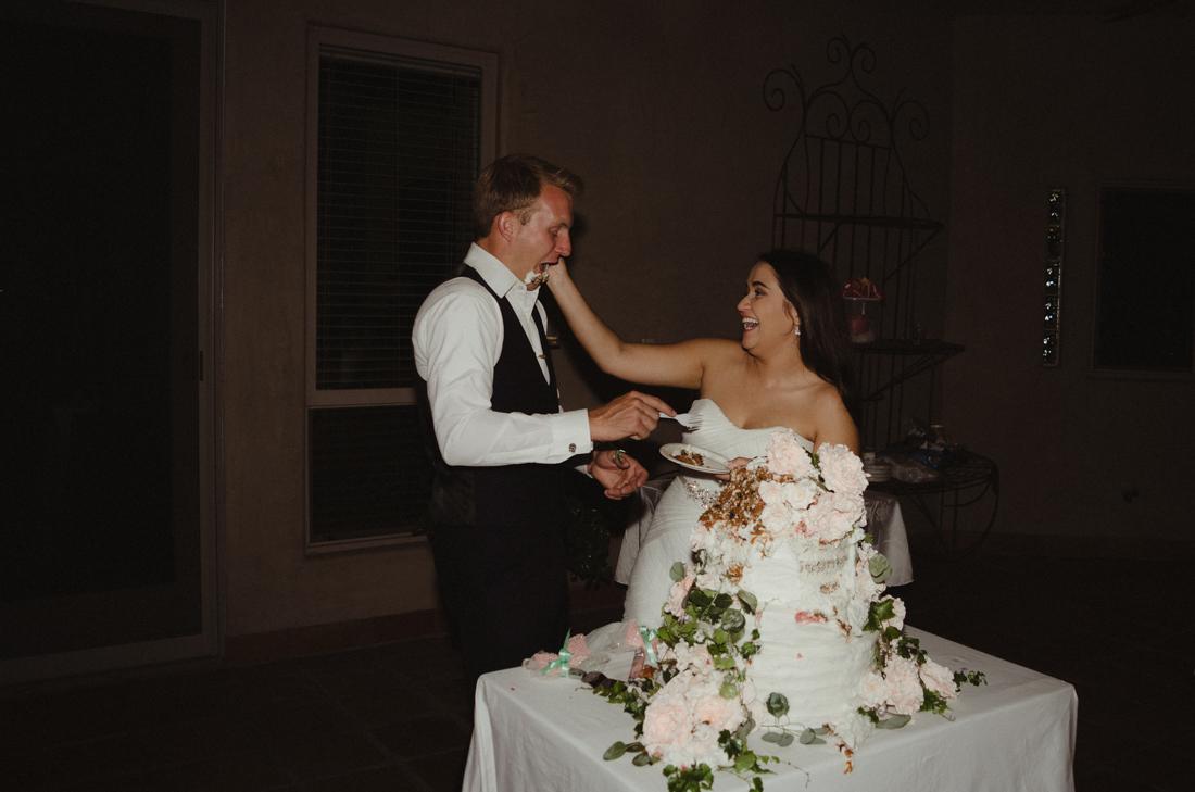 California Wedding private venue  bride and groom cutting the cake photo