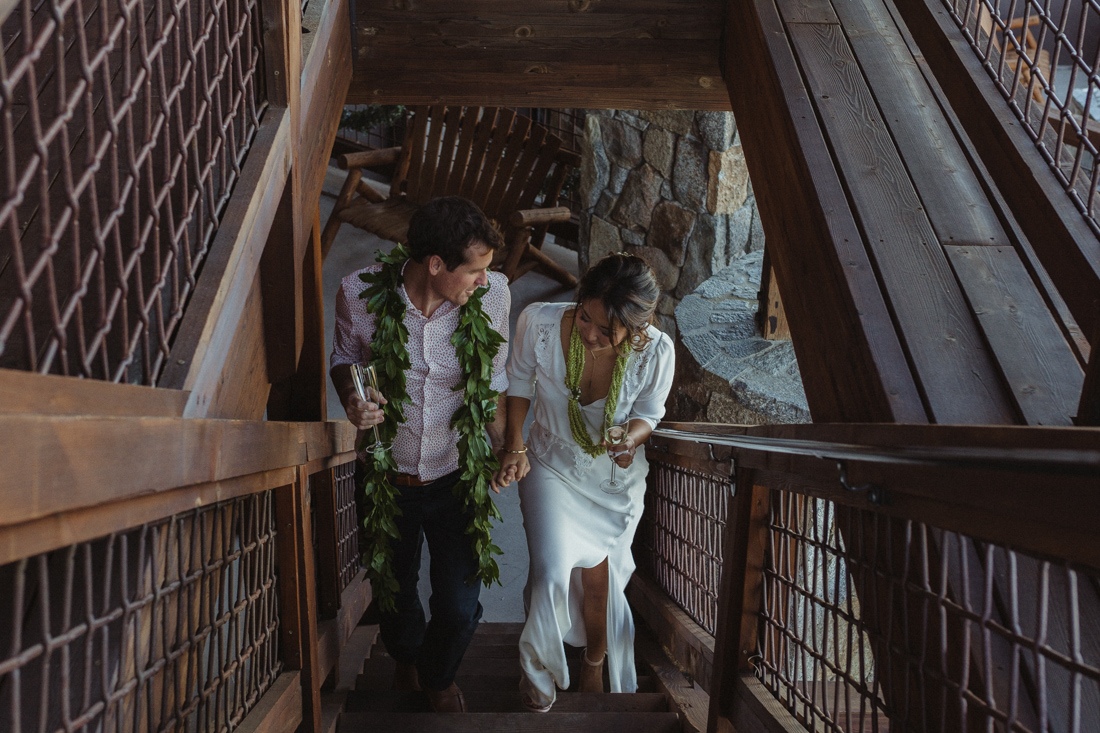 North Tahoe Lodge Wedding couple walking up the stairs photo