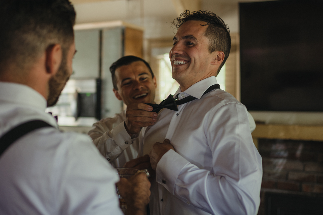 Incline Village wedding groomsmen helping groom get ready photo