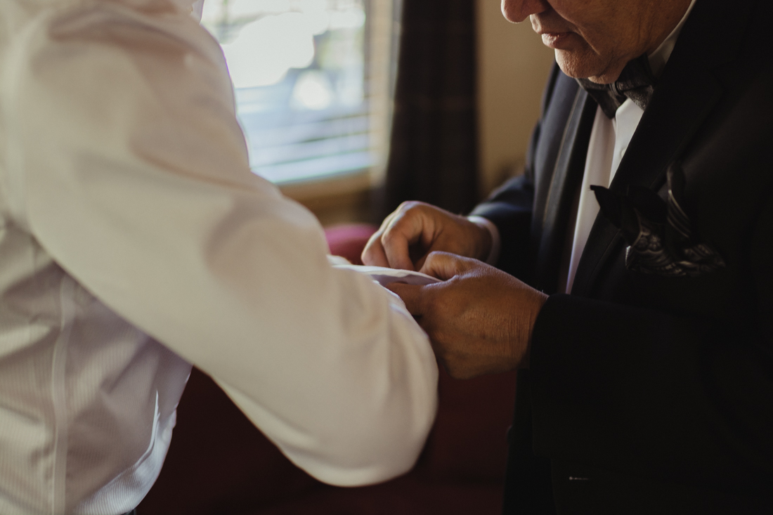 Incline Village wedding dad helping groom with his cuff photo