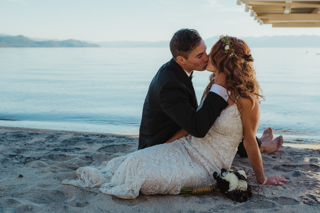 Incline village beach wedding couple sitting by the beach photo