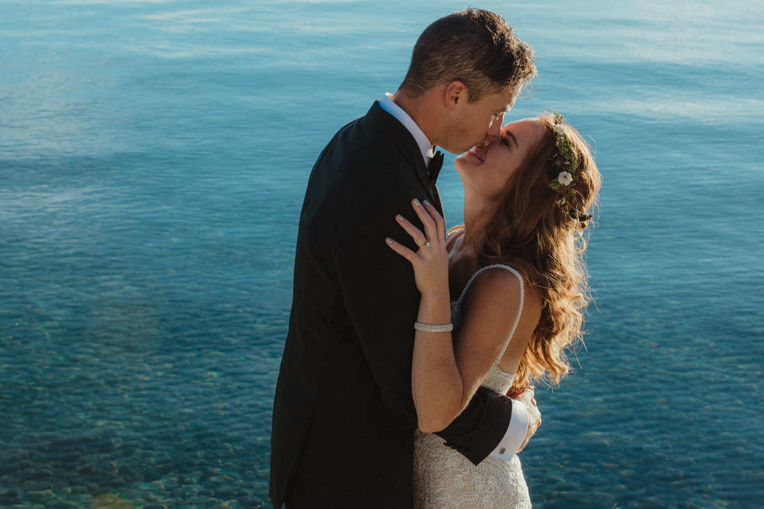Incline village beach wedding couple embracing photo