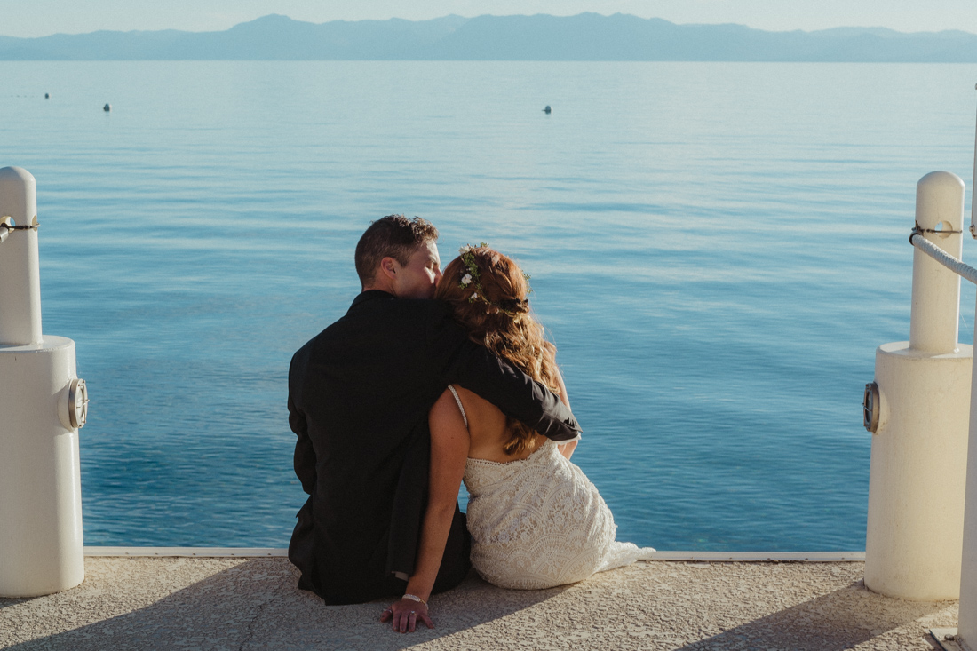 Incline village beach wedding couple sitting on the dock photo