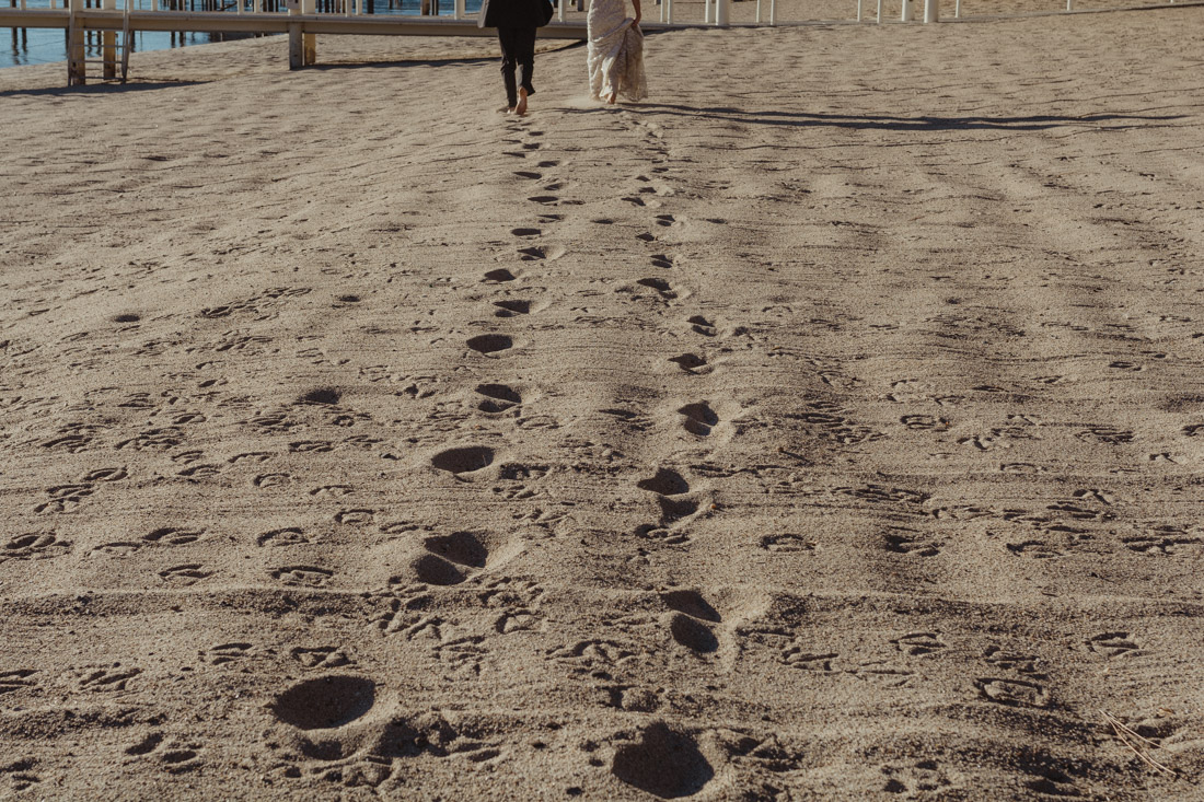 Incline village beach wedding couple running on the sand photo
